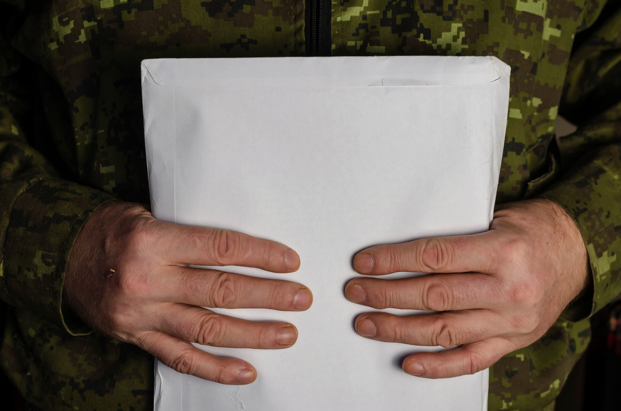A military man is holding a Large Mail Package - dasg